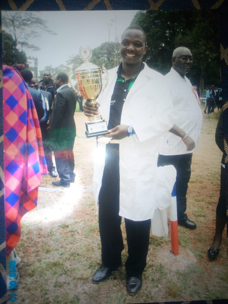 Robert Macharia with a trophy